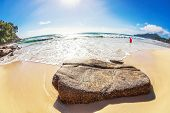 fisheye view on beach and sea with blue sky and sun