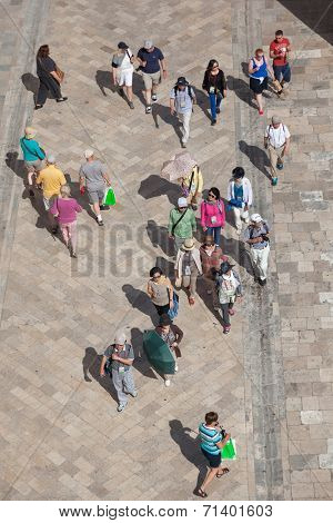 DUBROVNIK, CROATIA - MAY 26, 2014: Aerial view from old city walls of tourists walk on Stradun, 300 meters long main pedestrian street in Dubrovnik.