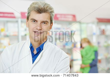 cheerful pharmacist chemist man in pharmacy drugstore