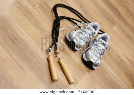 Jumping rope and trainers in gym
