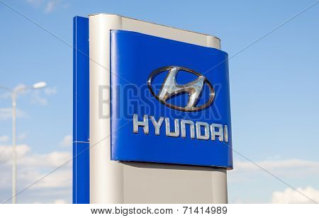 Samara, Russia - August 30, 2014: Hyundai Dealership Sign Against Blue Sky. Hyundai Motor Company Is