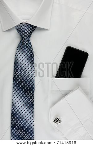 Shirt, Tie, Cuff Links And A Mobile Phone