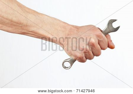 Hand of worker with a wrench close up