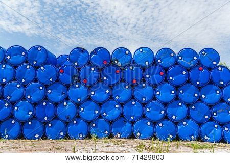 Plastic Blue Chemical Barrels Stacked Up.