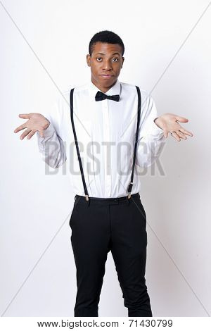 Portrait of young man shrugging against white background