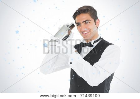 Handsome barkeeper shaking a drink against snow falling