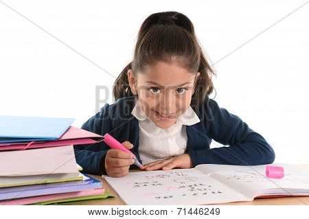Sweet Happy Latin Child Sitting On Desk Doing Homework And Smiling