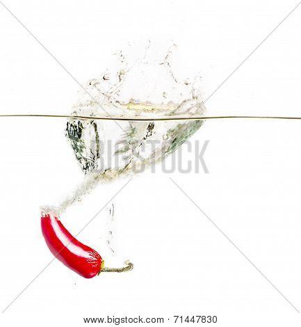 wet splashing RED hot chilli pepper