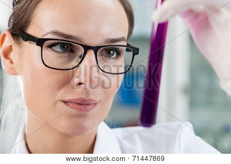 Woman Analyzing Test Tube