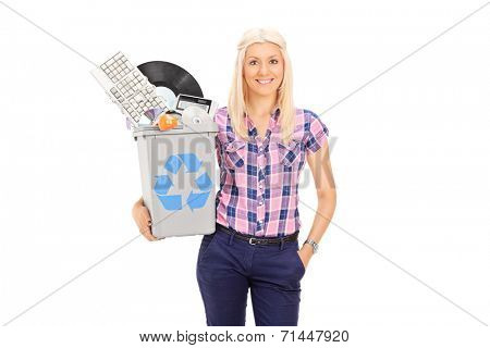 Girl holding recycle bin full of old accessories isolated on white background
