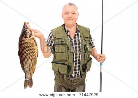 Mature fisherman holding big fish and fishing rod isolated on white background