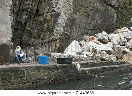 Italian grey bearded fisherman.