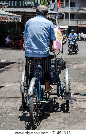 Cyclo man on the street