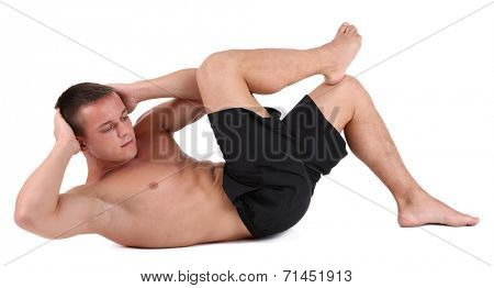 Handsome young muscular sportsman execute exercise isolated on white