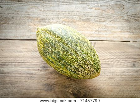 Piel De Sapo Melon On The Wooden Background