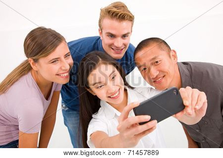 Happy Multiethnic Friends Taking Self Portrait With Cell Phone