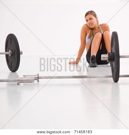 Woman Relaxing After Workout In Gym