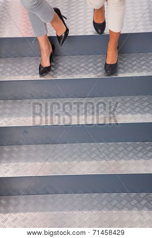 Close-up Of Two Women's Feet Moving Steps