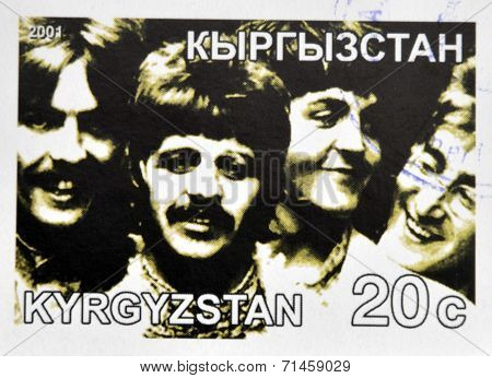 KIRZIGUISTAN - CIRCA 2001: stamp printed in Kirziguistan shows the Beatles circa 2001