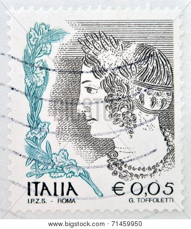 ITALY - CIRCA 2002: stamp printed in Italy shows Portrait of Etruscan art woman circa 2002