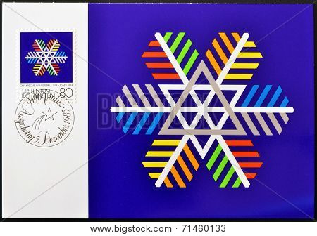 LIECHTENSTEIN - CIRCA 1983: A stamp printed in Liechtenstein shows coloured snow crystal circa 1983