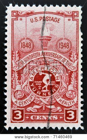 USA - CIRCA 1948: Stamp printed in USA shows the Torch and American Turner's Emblem Centenary