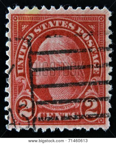 A stamp printed in USA shows the profile of George Washington