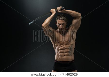 Mature Man Holding Sword Ready To Fight