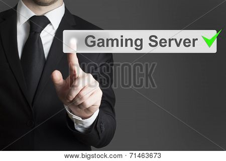 Businessman Pushing Button Gaming Server