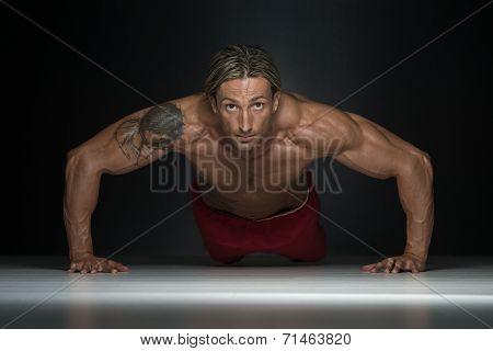 Middle Age Man Exercising In Studio Push Ups