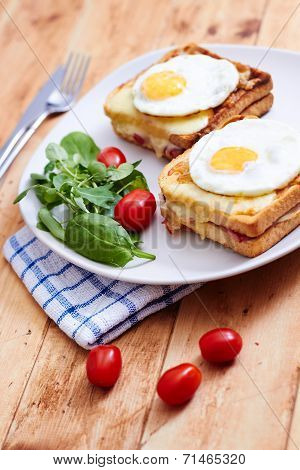 Croque madame on wooden table