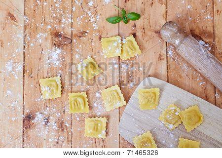 Raw ravioli pasta on table