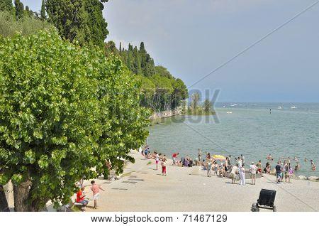 People Bathing In The Lake