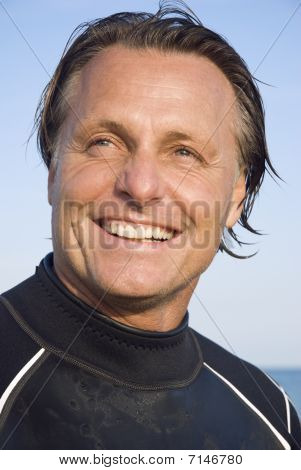 happy smiling man in wetsuit