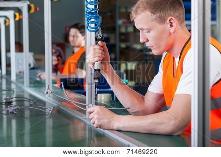 Concentrated Workers On Production Line