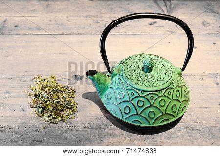 Green Teacup And Tea Herb