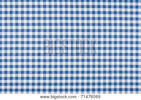 Macro shot of a Blue and white checkered tablecloth
