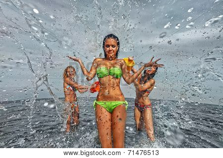 Sexy young girls on the beach have fun and laughing