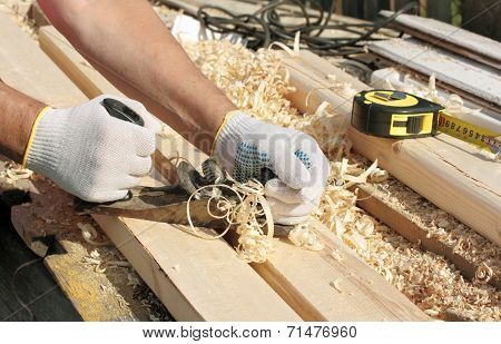Man hands with carpenters plane