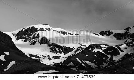 Snow capped mountains. Black and white.
