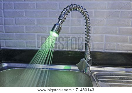 Ornate Iluminated Tap In Kitchen