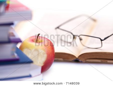 Book, apple and glasses