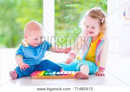 Kids Playing Music With Xylophone