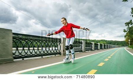 Beautiful Teenage Girl Roller-skating