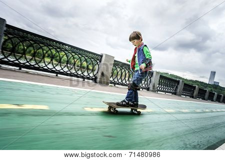 Little Preschooler Boy Learning Rollerskating