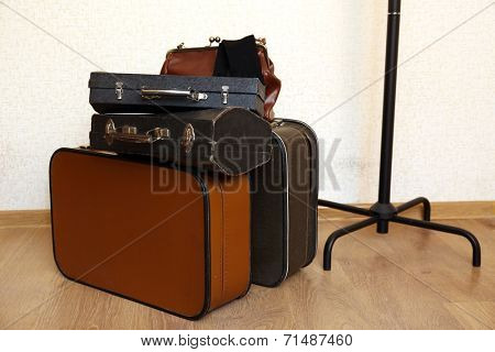 Vintage old travel suitcases on floor