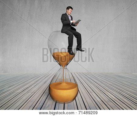 Man Use Smart Pad Sit On Sandglass