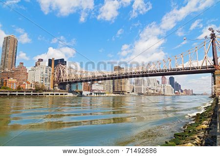 Queensboro Bridge over East River with view on Manhattan.