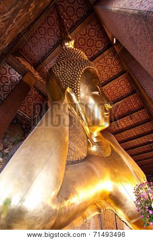 Half View Of Reclining Buddha In Wat Pho
