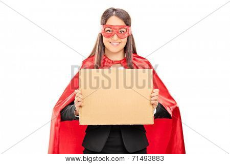 Female superhero holding a blank cardboard sign isolated on white background
